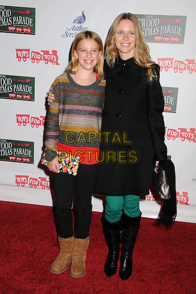 guest & Lauralee Bell.2012 Hollywood Christmas Parade held on Hollywood Blvd., Hollywood, California, USA.  .November 25th, 2012.full length black coat jacket beige stripe top jumper sweater leggings boots.CAP/ADM/BP.©Byron Purvis/AdMedia/Capital Pictures.