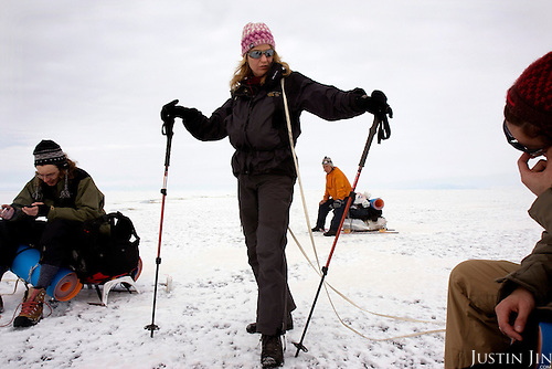 (Left to Right): Misha, Heleen, Arkady and Nastya rest as they trek across frozen Lake Baikal in Siberia, Russia. .They are a group of five people: Justin Jin (Chinese-British), Heleen van Geest (Dutch), Nastya and Misha Martynov (Russian) and their Russian guide Arkady. .They pulled their sledges 80 km across the world's deepest lake, taking a break on Olkhon Island. They slept two nights on the ice in -15c. .Baikal, the world's largest lake by volume, contains one-fifth of the earth's fresh water and plunges to a depth of 1,637 metres..The lake is frozen from November to April, allowing people to cross by cars and lorries.