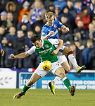 John McGinn charges Ross McCrorie off the ball and the ref awards a free kick to Hibs