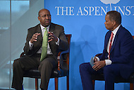 Washington, DC - April 8, 2014: Philadelphia Mayor Michael Nutter (l) participates in a panel discussion moderated by Fox News political analyst Juan Williams (r) at the Aspen Institute's 'Symposium on The State of Race in America.'  (Photo by Don Baxter/Media Images International)