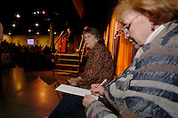 Thursday March 4, 2010      .Cheryl Zachary and Joanne Potts write down the official starting positions drawn by mushers at the musher's drawing banquet in Anchorage ...