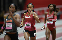 NWA Democrat-Gazette/ANDY SHUPE<br /> Arkansas' Kethlin Campbell carries the baton Saturday, Feb. 9, 2019, during her leg of the 4x400 meters during the Tyson Invitational in the Randal Tyson Track Center in Fayetteville. Visit nwadg.com/photos to see more photographs from the meet.
