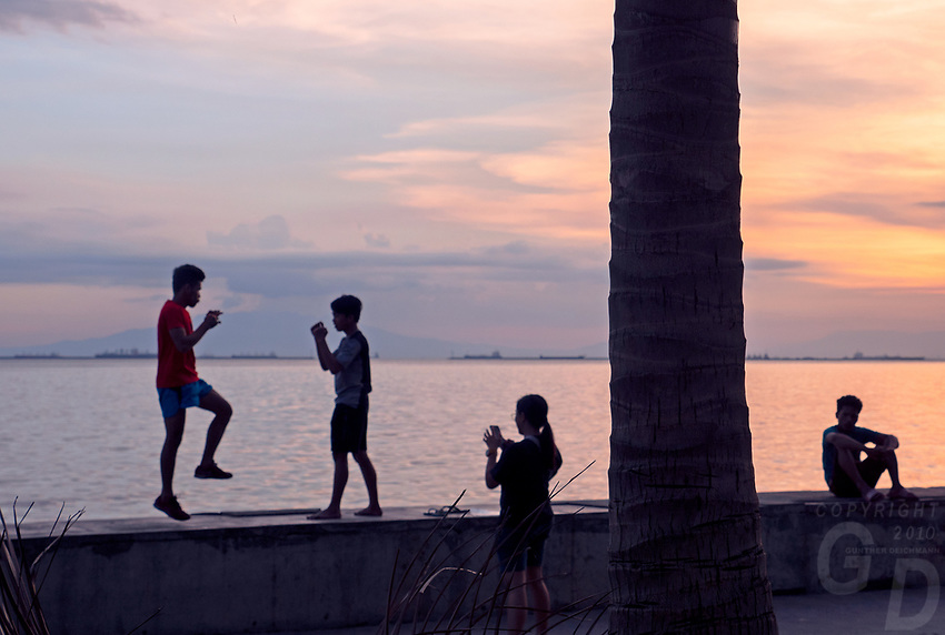 Manila, Philippines all walks of life. Street Photography Practicing Martial Arts at Sunset