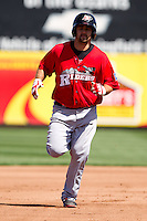 Tommy Mendonca (24) of the Frisco RoughRiders rounds the bases after hitting a home run during a game against the /s/ on April 16, 2011 at Hammons Field in Springfield, Missouri.  Photo By David Welker/Four Seam Images
