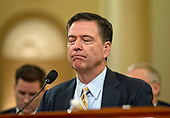 "James Comey, Director of the Federal Bureau of Investigation gives testimony before the United States House Permanent Select Committee on Intelligence (HPSCI) on the ""Russian Active Measures Investigation"" on Capitol Hill in Washington, DC on Monday, March 20, 2017.<br /> Credit: Ron Sachs / CNP<br /> (RESTRICTION: NO New York or New Jersey Newspapers or newspapers within a 75 mile radius of New York City)"