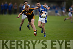 Johnny Buckley of Dr Crokes keeps an eye on Kerins O'Rahillys Con Barrett in the last round game of the Senior Club Championship in Strand Road on Saturday evening.