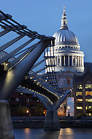 Millenium Bridge, London, UK, 2000, by the architect Sir Norman Foster with sculptor Sir Anthony Caro and engineers Arup, with St Paul's Cathedral, 1675-1710, by architect Sir Christopher Wren, in the background. The 325m suspension footbridge was the first new Thames crossing in 100 years and links the city to Southwark. The 111 metre high dome and twin towers peep over the surrounding buildings. Picture by Manuel Cohen