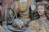 The revenge of Herodias, with the head of St John on a plate, polychrome high relief in the second row on the North side of the Gothic choir screen in the North ambulatory, 1490-1530, commissioned by canon Adrien de Henencourt and made by the sculptor Antoine Ancquier, depicting the life of St John the Baptist, at the Basilique Cathedrale Notre-Dame d'Amiens or Cathedral Basilica of Our Lady of Amiens, built 1220-70 in Gothic style, Amiens, Picardy, France. Amiens Cathedral was listed as a UNESCO World Heritage Site in 1981. Picture by Manuel Cohen