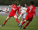Raith's Dougie Hill fouled in the box by Dumbarton's Paul McGinn for a penalty kick