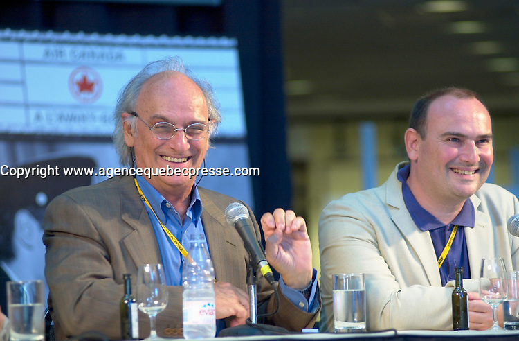Aug 27,  2002, Montreal, Quebec, Canada<br /> <br /> Carlos Saura, Film Maker (R) <br />  and his son Antonio Saura, Producer (L), give a press conference about the film SALOME, presented in the Official Competition of the 26th Montreal World Film Festival, Aug 27 2002<br /> <br /> Spain's best known director, Carlos Saura was born in 1932 and was strongly influenced, in his childhood, by his pianist mother and his artist older brother. He studied journalism and cinema before opting for the latter and making his directorial debut in 1958 with the short, Cuenca. The following year he made his first feature film, LOS GOLFOS, and he quickly moved into the vanguard of the new Spanish cinema. His films include: THE HUNT (1965), PEPPERMINT FRAPP&hellip; (1967), THE GARDEN OF DELIGHTS (1970), ANNA AND THE WOLVES (1972), COUSIN ANGELICA (1973), RAISE RAVENS (1975), BLINDFOLD (1978), BLOOD WEDDING (1981), CARMEN (1983), THE STILTS (1984), EL AMOR BRUJO (1985), EL DORADO (1987), THE DARK NIGHT (1989), FLAMENCO (1995), PAJARICO (1996), TANGO (1998) and GOYA IN BORDEAUX (1999). Many of these have been shown at the Montreal World Film Festival. <br /> <br /> <br /> <br /> <br /> Mandatory Credit: Photo by Pierre Roussel- Images Distribution. (&copy;) Copyright 2002 by Pierre Roussel <br /> <br /> NOTE : <br />  Nikon D-1 jpeg opened with Qimage icc profile, saved in Adobe 1998 RGB<br /> .Uncompressed  Uncropped  Original  size  file availble on request.