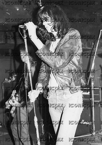 THE RAMONES - vocalist Joey Ramone - performing live at Eric's Club in Liverpool Uk - 19 May 1977.  Photo credit: Ian Dickson/IconicPix