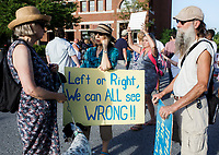 NWA Democrat-Gazette/CHARLIE KAIJO (From left) Annee Littell of Fayetteville, Karen Bley of Morrow and John Remmers of Morrow chat while holding signs during a rally, Saturday, June 30, 2018 at the downtown square in Fayetteville. <br /> <br /> The rally in Fayetteville is one of hundreds of rallies planned as part of a Families Belong Together national day of action to protest the administration&rsquo;s &ldquo;zero tolerance&rdquo; immigration policy, which remains in effect. Advocacy groups such as MoveOn, the Human Rights Campaign and the American Civil Liberties Union have joined in, and at least 130 rallies in 48 states are planned.