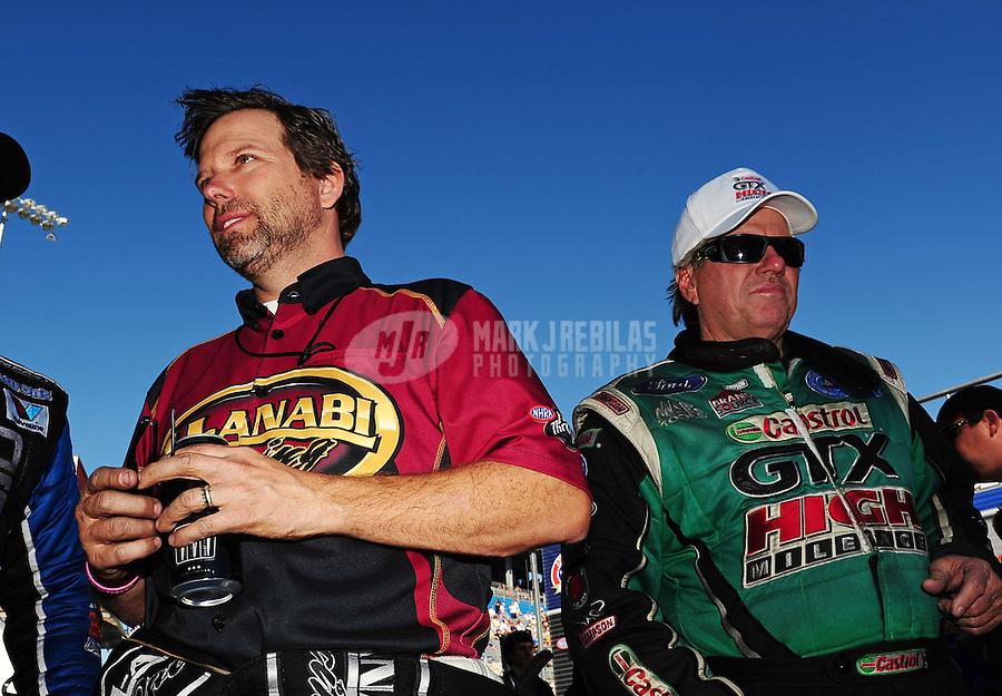 Oct. 30, 2011; Las Vegas, NV, USA: NHRA funny car driver John Force (right) talks with top fuel dragster driver Del Worsham before the Big O Tires Nationals at The Strip at Las Vegas Motor Speedway. Mandatory Credit: Mark J. Rebilas-