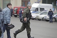Moscow, Russia, 29/03/2010..Scenes outside Lubyanka metro station, where at least 24 people were killed in a morning rush hour suicide bombing. A second bomb exploded at Park Kultury metro station, killing at least another 14 people. FSB bomb squad officers running to the metro station..