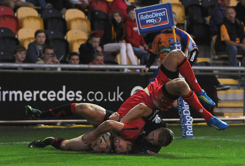 Edinburgh Rugby's Tom Brown scores his sides first try while under pressure from Newport Gwent Dragons' Tom Prydie ..Rugby Union - RaboDirect PRO12 - Newport-Gwent Dragons v Edinburgh Rugby - Friday 28th September 2012 -  Rodney Parade - Newport....
