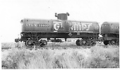 Side view of UTLX 11037 tank car - Gramps.  Renumbered x88153 and x58432.<br /> D&amp;RGW  Alamosa, CO  Taken by Maxwell, John W. - 7/3/1959