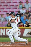 Christian Arroyo #15 of the Salem-Keizer Volcanoes bats against the Spokane Indians at Volcanoes Stadium on July 26, 2014 in Keizer, Oregon. Spokane defeated Salem-Keizer, 4-1. (Larry Goren/Four Seam Images)