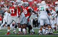 Ohio State Buckeyes defensive lineman Joey Bosa (97) shrugs after sacking Hawaii Warriors quarterback Max Wittek (13) during the second quarter of the NCAA football game at Ohio Stadium in Columbus on Sept. 12, 2015. (Adam Cairns / The Columbus Dispatch)