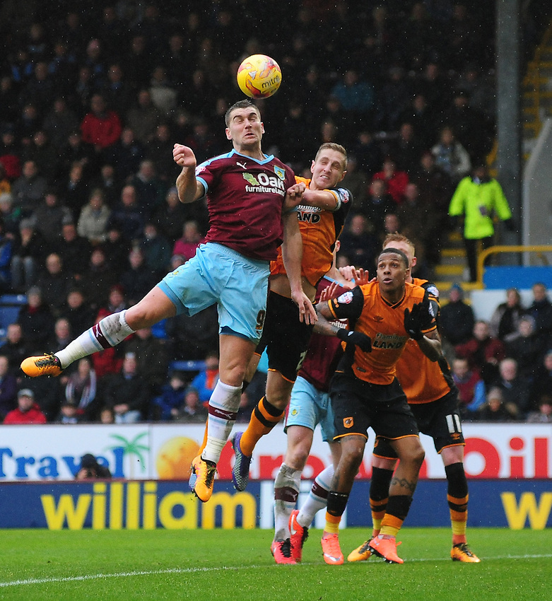 Burnley's Sam Vokes beats Hull City's Hull City's Michael Dawson to a high ball<br /> <br /> Photographer Chris Vaughan/CameraSport<br /> <br /> Football - The Football League Sky Bet Championship - Burnley v Hull City - Saturday 6th February 2016 - Turf Moor - Burnley <br /> <br /> &copy; CameraSport - 43 Linden Ave. Countesthorpe. Leicester. England. LE8 5PG - Tel: +44 (0) 116 277 4147 - admin@camerasport.com - www.camerasport.com