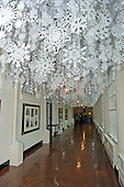 """Snowflakes representing each of the 56 states and territories that make-up the United States hang from the ceiling of the East Colonnade as part of the 2015 White House Christmas theme """"A Timeless Tradition"""" at the White House in Washington, DC on Wednesday, December 2, 2015.<br /> Credit: Ron Sachs / CNP"""
