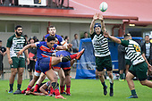 Willian Raea attempts to charge down Katetistoti Nginingini's clearing kick. Counties Manukau Premier Club Rugby game between Ardmore Marist and Manurewa, played at Bruce Pulman Park Papakura on Saturday May 12th 2018. Ardmore Marist won the game 20 - 3 after leading 17 - 3 at halftime.<br /> Ardmore Marist - Katetistoti Nginingini try, penalty try, Latiume Fosita conversion, Latiume Fosita 2 penalties.<br /> Manurewa - Logan Fonoti penalty.<br /> Photo by Richard Spranger.