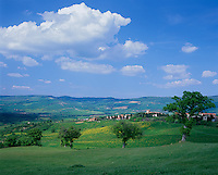 Tuscany, Italy      <br /> View of the rolling hills and valley of Val d'Orcia and the hilltown of Contignano