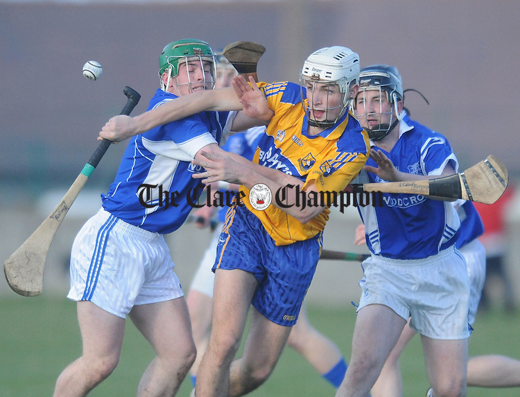 John Fennessey of Sixmilebridge fights for posession with Sean Collins of Cratloe. Photograph by Declan Monaghan