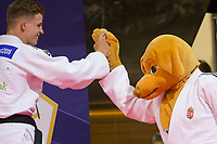 Miklos Ungvari (L) of Hungary celebrates his victory during an awards ceremony after the Men -73 kg category at the Judo Grand Prix Budapest 2018 international judo tournament held in Budapest, Hungary on Aug. 11, 2018. ATTILA VOLGYI