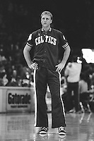 OAKLAND, CA - Larry Bird of the Boston Celtics stands on the court during warm ups before a game against the Golden State Warriors at the Oakland Coliseum Arena in Oakland, California in 1988. Photo by Brad Mangin