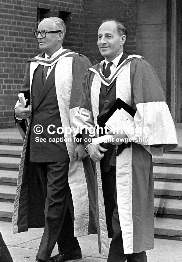 N Ireland Prime Minister, Captain Terence O'Neill, right, and Dr Michael Grant, former vice-chancellor, Queen's University, Belfast, N Ireland, in the academic procession after they received honorary degrees at the Queen's  summer graduation ceremony July 1967. 196607000167a.<br />