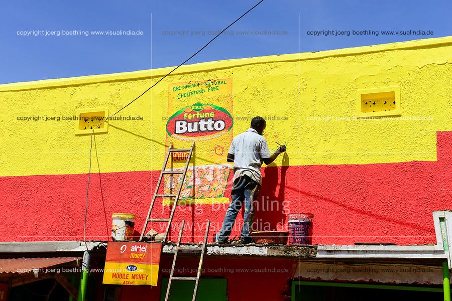 UGANDA, Kasese,  painting of advertising sign / Fassadenmaler
