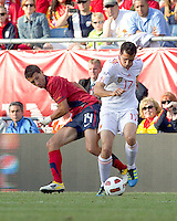 Spain defender Alvaro Arbeloa (17) controls the ball as USA defender   Eric Lichaj (14) defends. In a friendly match, Spain defeated USA, 4-0, at Gillette Stadium on June 4, 2011.