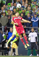 Chicago Fire midfielder Marco Pappa battle for the ball with Seattle Sounders FC midfielder Lamar Neagle during play between the Seattle Sounders FC and the Chicago Fire in the U.S. Open Cup Final at CenturyLink Field in Seattle Tuesday October 4, 2011. Seattle won the game 2-0 to win its third U.S. Open Cup.