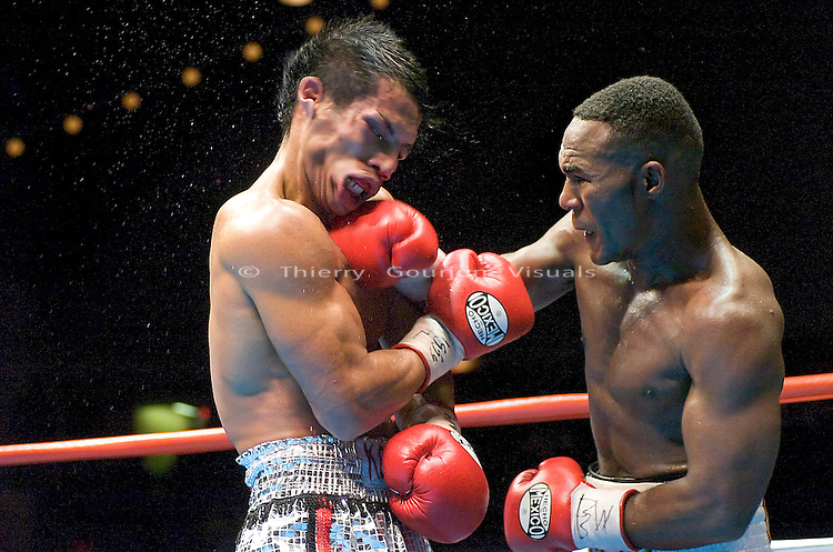 Joan Guzman lands hard against Terdsak Jandaeng (l) during their WBO Featherweight Eliminator Fight at the Westchester County Center, White Plains, NY on 08.26.2005..Guzman won by unanimous decision.