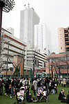 March 11, 2011, Tokyo, Japan - A crowd takes refuge at a local school ground in Tokyo's Ikebukuro area following a severe earthquake that struck Japan's northeastern prefectures on Friday, March 11, 2011. Hundreds of people are feared dead after the country's biggest earthquake with a magnitude of 8.9 since records began struck the northeastern coasts, unleashing a 10-metre tsunami that swept away buildings, ships and vehicles. (Photo by AFLO) [3609] -mis-
