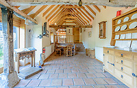 BNPS.co.uk (01202 558833)<br /> Pic: JacksonStops/BNPS<br /> <br /> Barn Find - stunning former tithe barn next door to a medieval castle for sale...<br /> <br /> The exceptional Grade II Listed barn conversion is at the foot of the picturesque South Downs and has emerged for sale for £2.5m.<br /> <br /> The charming home in Amberley, West Sussex, enjoys breathtaking country views of the idyllic national park and sits in the shadow of 12th century Amberley castle, formerley the fortified 'Summer Palace' of the Bishops of Chichester, <br /> as well as a local nature reserve.<br /> <br /> The huge barn dates back to the 17th century but was loving transformed into the idyllic home around 16 years ago