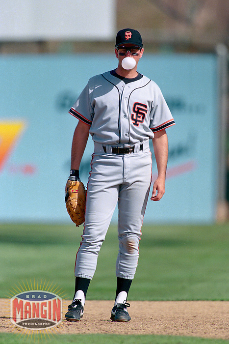 PHOENIX, AZ - Will Clark of the San Francisco Giants blows a bubble as he plays defense at first base during a spring training game against the Oakland Athletics at Phoenix Municipal Stadium in Phoenix, Arizona in 1992. Photo by Brad Mangin