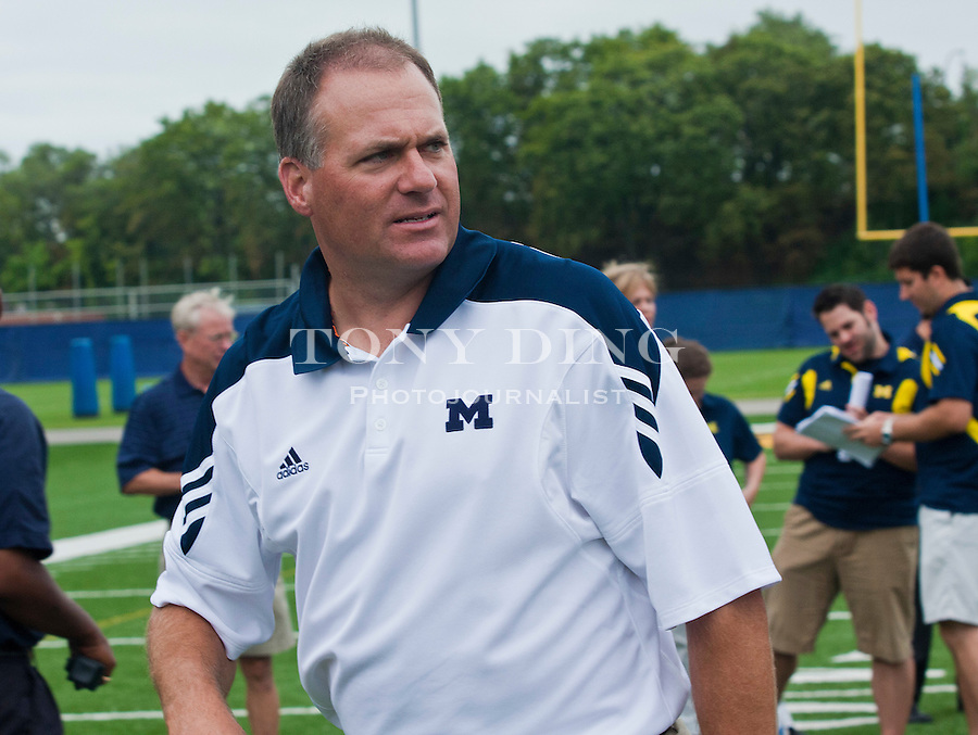 Michigan head coach Rich Rodriguez at the annual NCAA college football media day, Sunday, Aug. 22, 2010, in Ann Arbor, Mich. (AP Photo/Tony Ding)