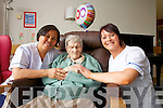 Nora Villaluz and Jean Thomas pictured with Hannah Mary Fitzgerald on her 100th birthday at Tralee Community Hospital on Wednesday.