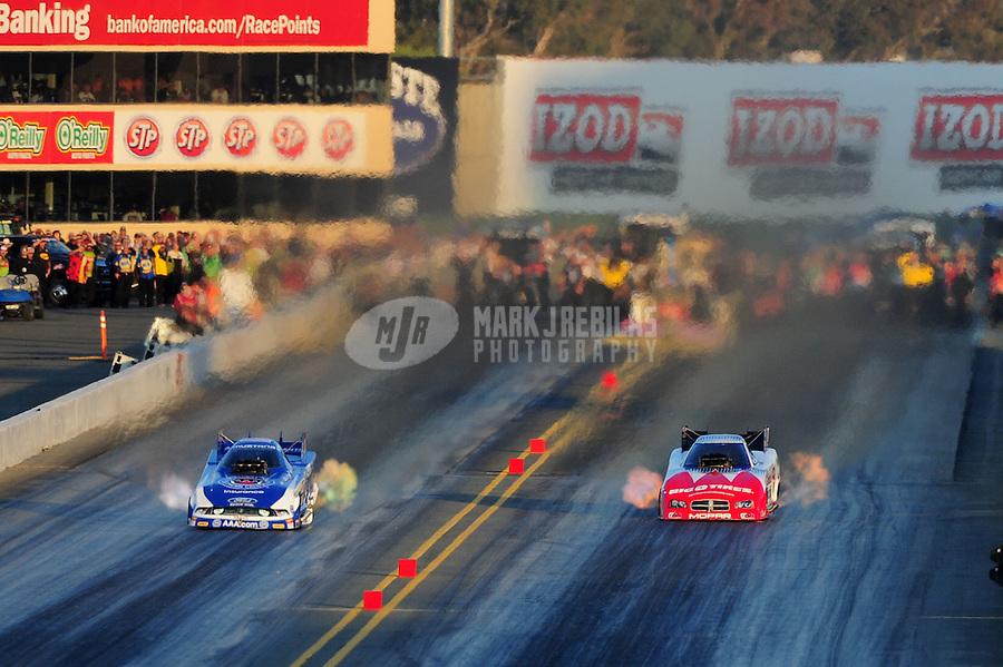 Jul. 29, 2011; Sonoma, CA, USA; NHRA funny car driver Robert Hight (left) races alongside Johnny Gray during qualifying for the Fram Autolite Nationals at Infineon Raceway. Mandatory Credit: Mark J. Rebilas-