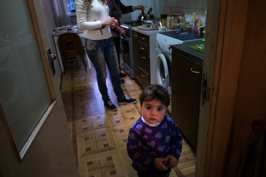 Syrian Armenian family who fled Aleppo are now living in Yerevan. A local Armenian woman volunteers to help them with issues of integration. Volunteer Lia Tevosyan meets with the Ohannesian family who migrated from Syrian. Lia participates in the UNHCR-KASA joint project &quot;Adopt a Family which brings together Armenian volunteers and Syrian-Armenian refugees as they settle in Armenia. <br />