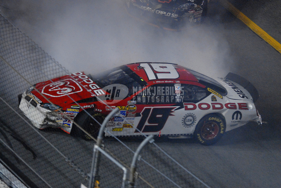 Feb 10, 2007; Daytona, FL, USA; Nascar Nextel Cup driver Elliott Sadler (19) crashes on the last lap during the Budweiser Shootout at Daytona International Speedway. Mandatory Credit: Mark J. Rebilas