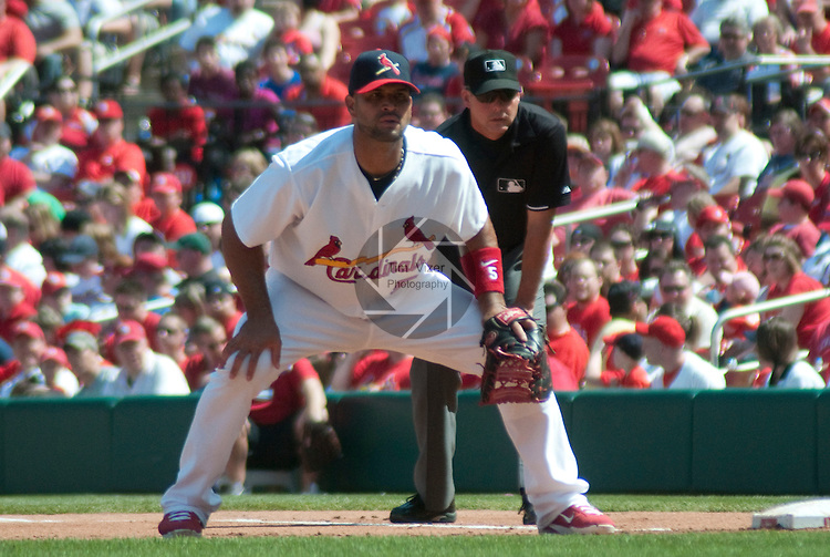 April 3,  2011                           St. Louis Cardinals first baseman Albert Pujols (5) at first base, and behind him is first base umpire Tim Timmons (95). The St. Louis Cardinals defeated the San Diego Padres 2-0 in the final game of a three-game series on Sunday April 3, 2011 at Busch Stadium in downtown St. Louis.