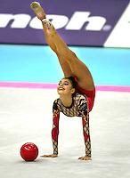 01 OCTOBER 1999 - OSAKA, JAPAN: Alina Kabaeva of Russia performs with ball in All-Around final at the 1999 World Championships in Osaka, Japan. Alina won gold and eventually won Olympic gold at Athens 2004.