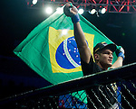 Junior Dos Santos holds up a Brazilian flag after winning the World Heavyweight Championship during Saturday's UFC on Fox.