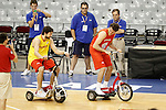 Spain's Rudy Fernandez (l) and Sergio LLull have fun with a mini electric bikes during training session.July 23,2012(ALTERPHOTOS/Acero)