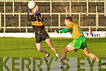 Dr Crokes Colm Cooper fists this ball over the bar despite the best efforts of Gneeveguilla's Fergus McAulliffe during their O'Donoghue Cup final clash in the Fitzgerald Stadium, Killarney on Sunday.