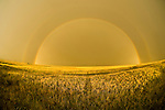 Rainbow with secondary bow, clearing thunderstorm on the Great Plains of Colorado.