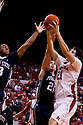 11 January 2012: Jorge Brian Diaz #21 of the Nebraska Cornhuskers grabs the rebound against Sasa Borovnjak #21 of the Penn State Nittany Lions during the first half at the Devaney Sports Center in Lincoln, Nebraska. Nebraska defeated Penn State 70 to 58.