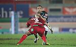 Deacon Manu stops Fetu'u Vainikolo..RaboDirect Pro12.Scarlets v Connacht.02.03.12.©STEVE POPE